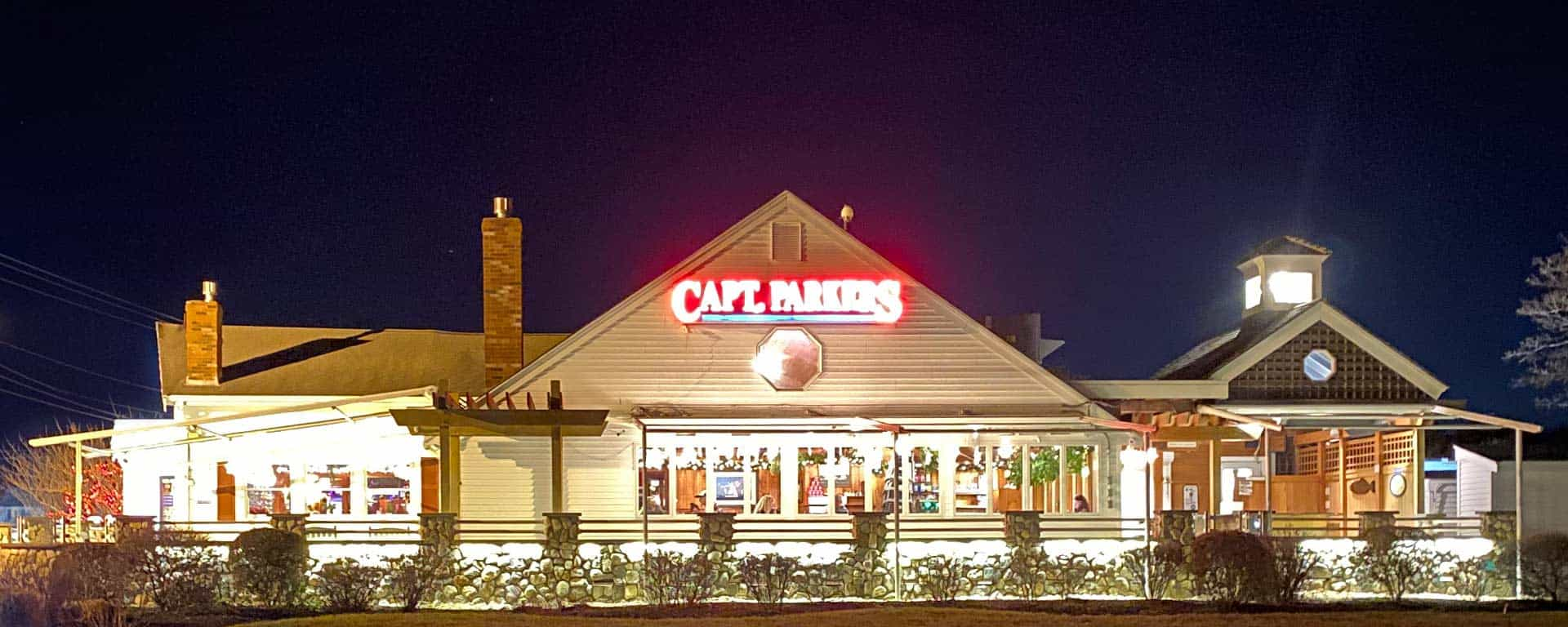 Captain Parkers at night with red sign