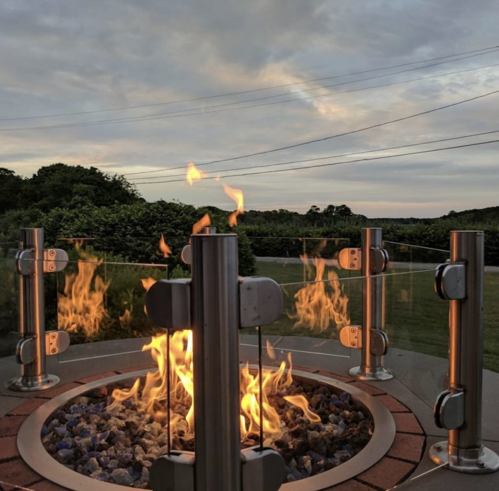 Firepit and sunset outside at Captain Parkers patio